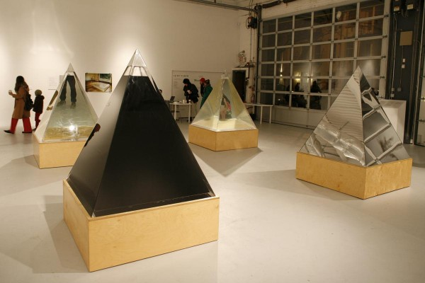 Agnes Denes. Pyramids of Conscience, 2005. Crude oil, tap water (City of New York), polluted water (New York harbor), the mirror, in which you see yourself make decisions about water for humanity.
