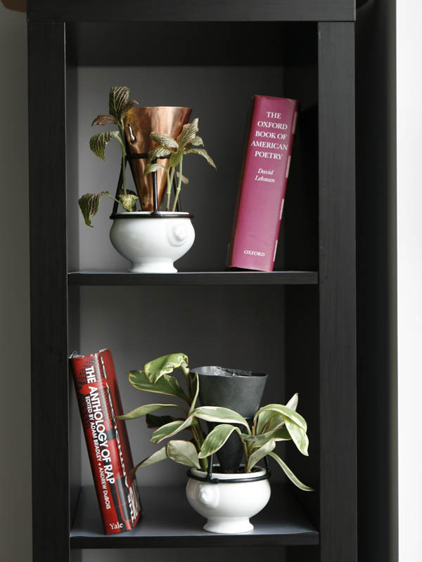 Two shelves, two books, two sculptures