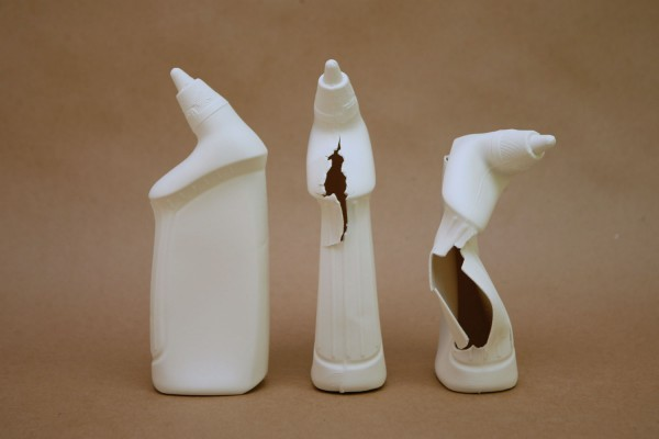 "Domestic Collapse #1. Porcelain. 2"" x 3.5"" x 9"" each of the 3 objects. 2014."