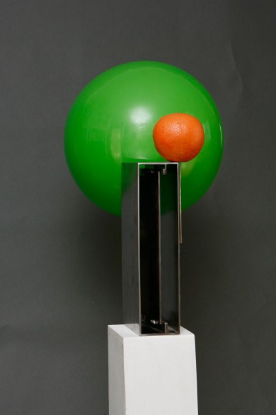 Metal sculpture with green ball